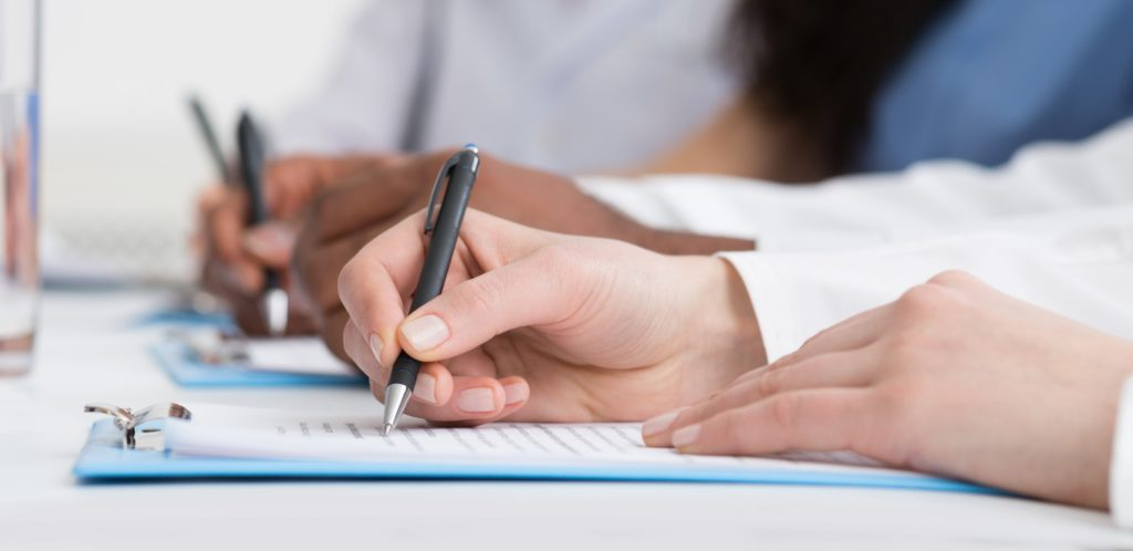 Medicine Concept. Doctors Writing Notes At Seminar